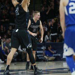 Utah State Aggies guard Sam Merrill (3) celebrates a basket in Logan on Saturday, Dec. 2, 2017. BYU won 75-66.