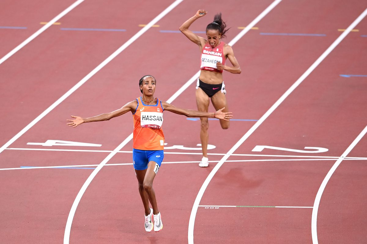 Sifan Hassan of Team Netherlands celebrates as she wins the gold medal in the Women's 10,000m Final on day fifteen of the Tokyo 2020 Olympic Games at Olympic Stadium on August 07, 2021 in Tokyo, Japan.