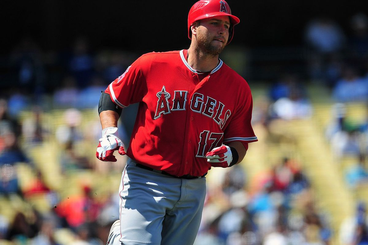 April 4, 2012; Los Angeles, CA, USA; Los Angeles Angels catcher Chris Iannetta (17) runs to first after hitting a single in the fourth inning against the Los Angeles Dodgers at Dodger Stadium. Mandatory Credit: Gary A. Vasquez-US PRESSWIRE