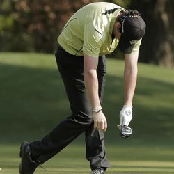 Europe's Rory McIlroy reacts after hitting a shot on the 10th hole during a four-ball match at the Ryder Cup PGA golf tournament Friday, Sept. 28, 2012, at the Medinah Country Club in Medinah, Ill. (AP Photo/Charlie Riedel)