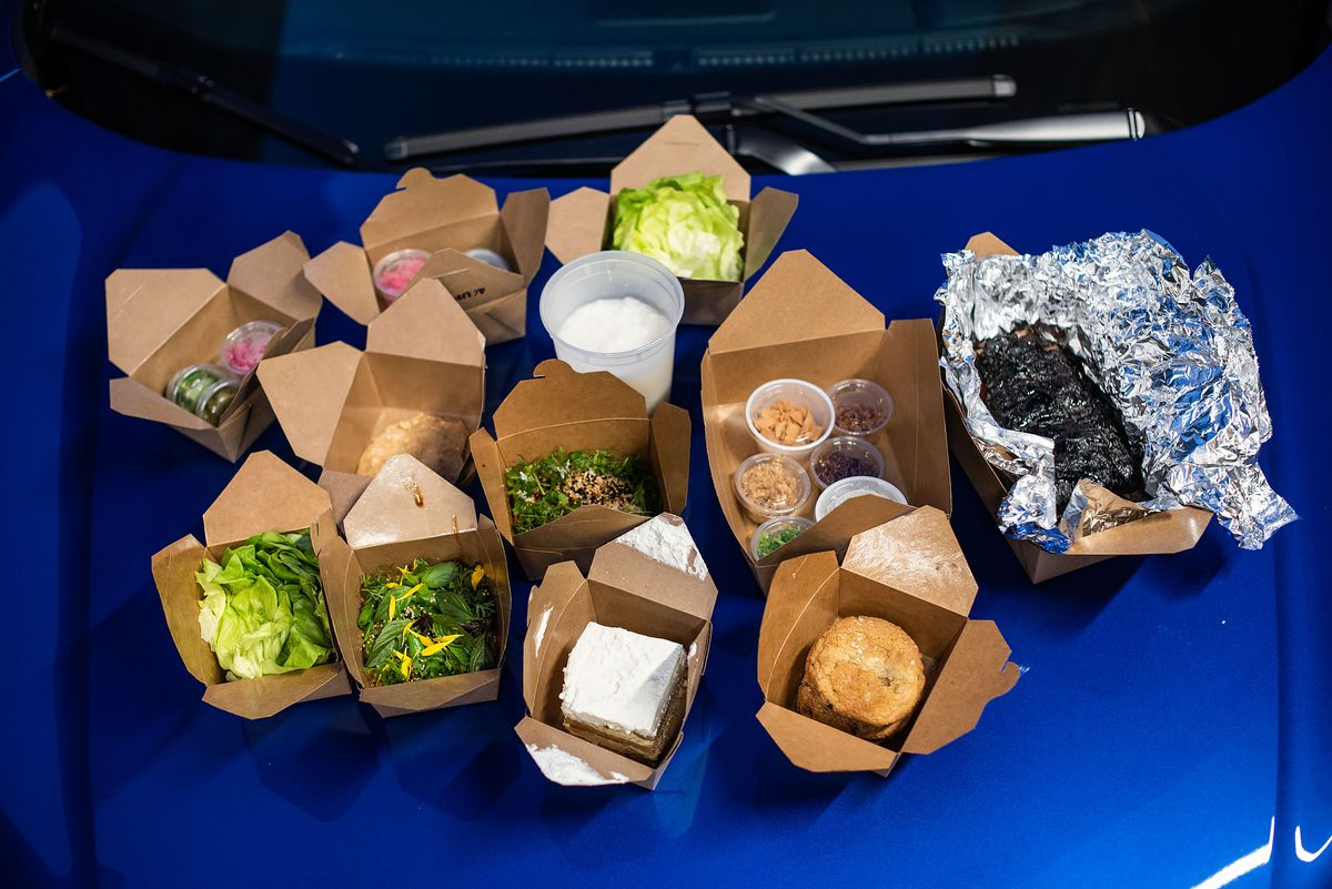Nightshade takeout meal on the hood of a car