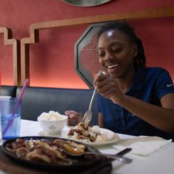 Nija Threat enjoys her lunch at Chi Cafe in the Chinatown.   Colin Boyle/Sun-Times