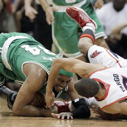 Boston Celtics' Paul Pierce (34) collides with Atlanta Hawks' Jannero Pargo during the second quarter of Game 1 of an opening-round NBA basketball playoff series, Sunday, April 29, 2012, in Atlanta.