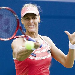 Elena Dementieva of Russia, hits a forehand on her way to defeating Serena Williams of the United States.