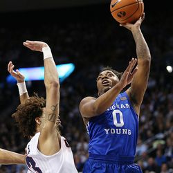 Brigham Young Cougars guard Jahshire Hardnett (0) pushes up a shot with Gonzaga Bulldogs guard Josh Perkins (13) defending as BYU and Gonzaga play in an NCAA basketball game in the Marriott Center in Provo on Saturday, Feb. 24, 2018.