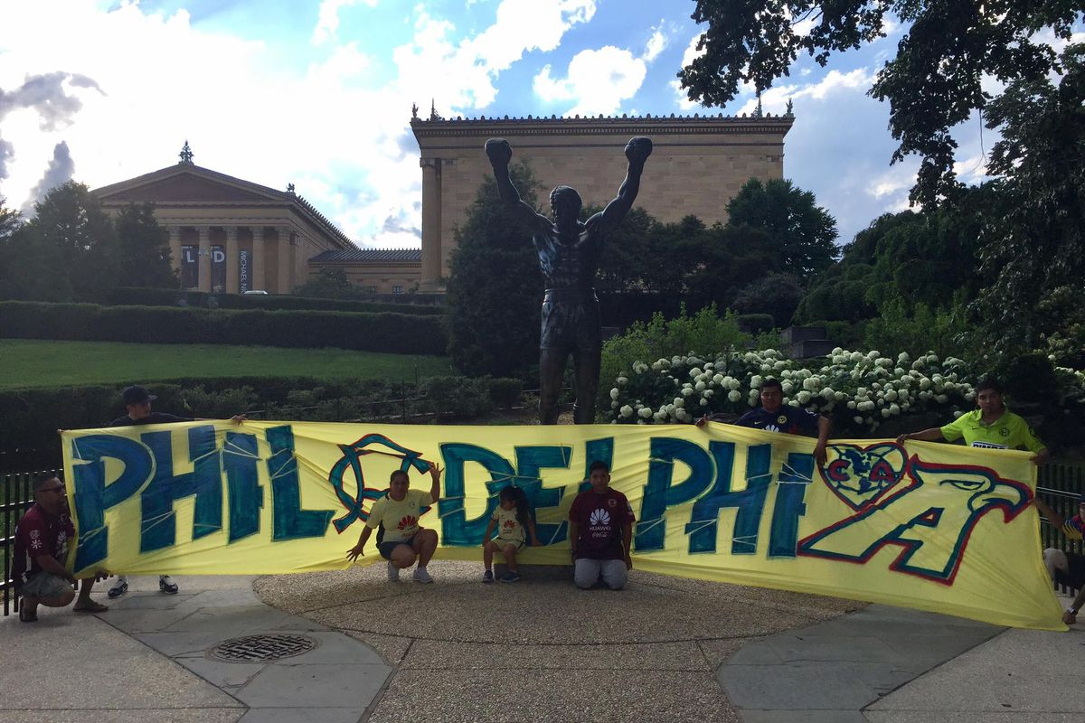 La Monumental fans in front of the iconic Rocky statue in Philadelphia.
