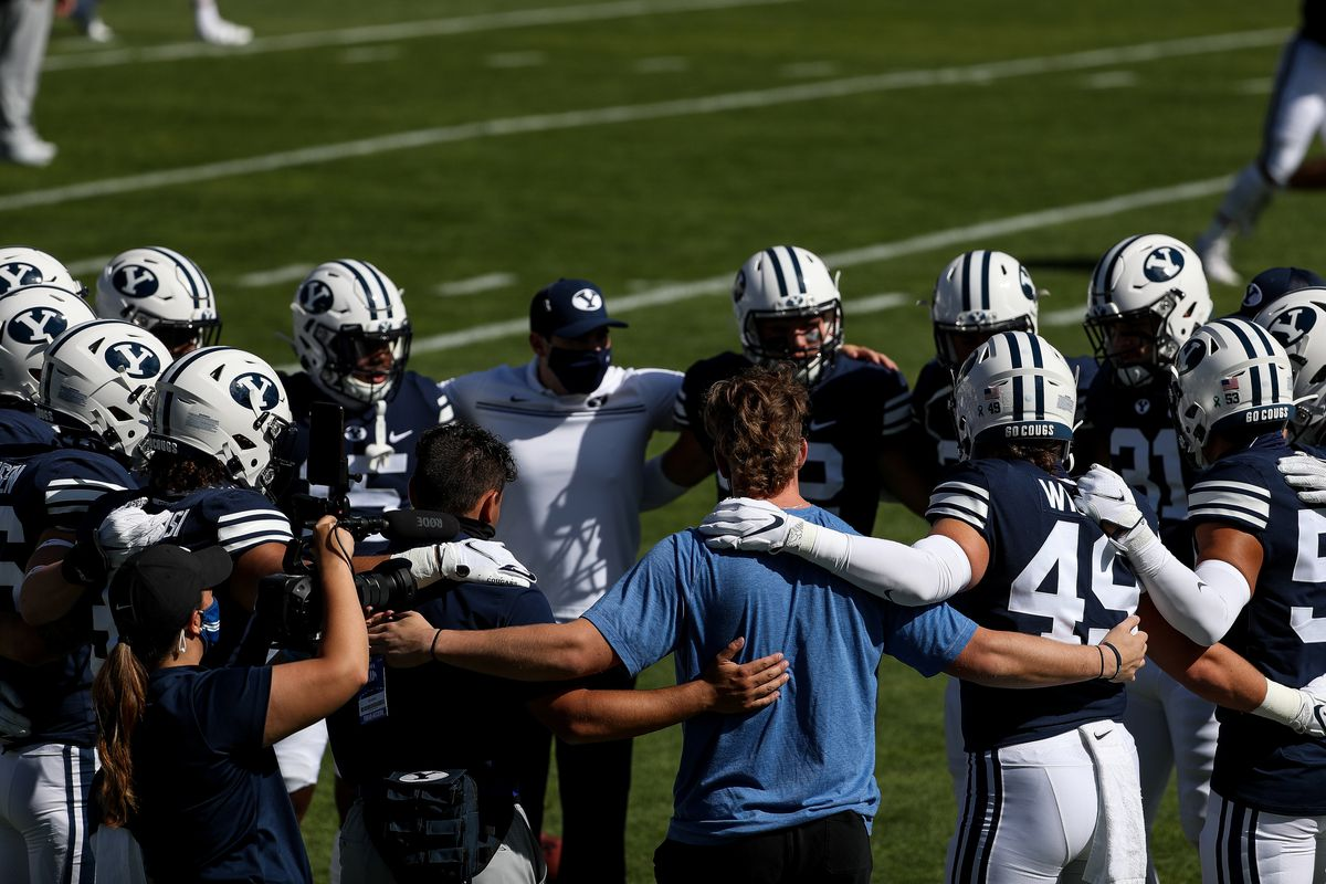 Brigham Young Cougars players huddle before the game against UTSA. The program got its third commitment from an offensive lineman in five days from Pine View's Peter Falaniko.