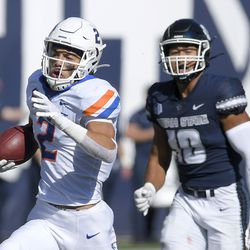 Boise State wide receiver Khalil Shakir (2) runs down the field after catching a pass as Utah State linebacker AJ Vongphachanh (10) defends during the first half of an NCAA college football game Saturday, Sept. 25, 2021, in Logan, Utah.