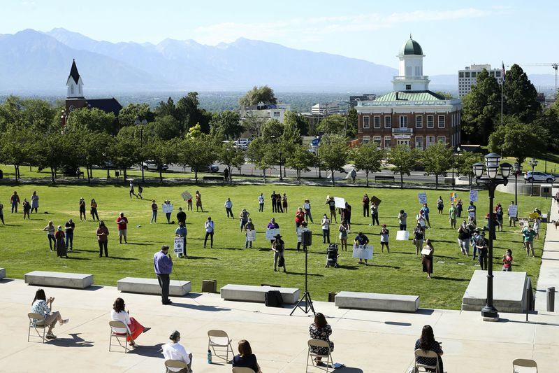 Teachers, parents and students maintain social distancing guidelines while attending a Utah Safe Schools Mask-In to urge the governor's leadership in school reopenings at the Capitol in Salt Lake City on Thursday, July 23, 2020.