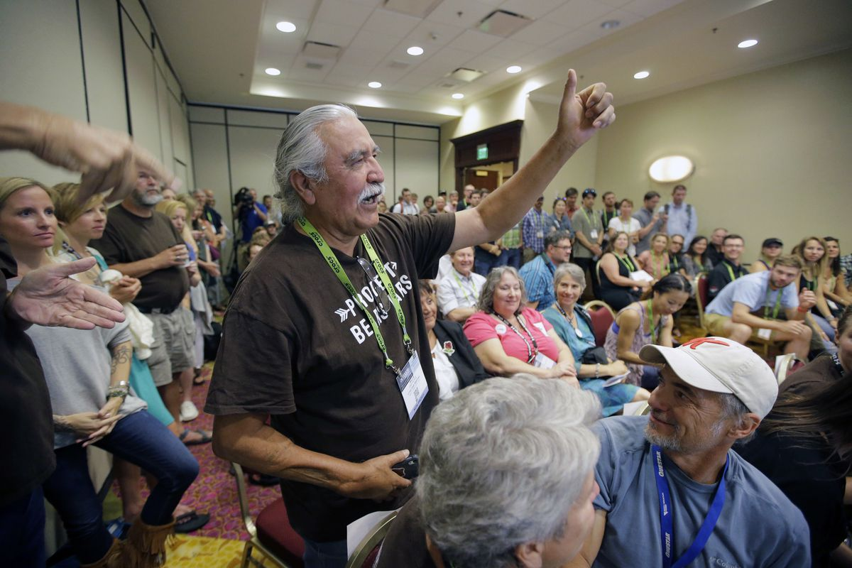 FILE - This Aug. 4, 2016, file photo, Willie Grayeyes raises his hand as he is recognized during a news conference, in Salt Lake City. A Navajo man will be put back on the ballot for county commission after a judge sided with him in his lawsuit against a
