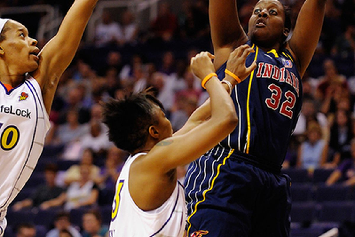 Indiana Fever forward Ebony Hoffman -- who poured in an unexpected  career-high of 27 points on 12-14 shooting -- scores over Phoenix Mercury guard Cappie Pondexter (bottom) and center Tangela Smith (left).