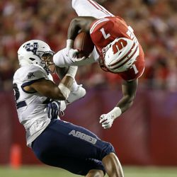 Utah State's Suli Tamaivena, left, upends Wisconsin running back Bradrick Shaw during the second half of an NCAA college football game Friday, Sept. 1, 2017, in Madison, Wis.