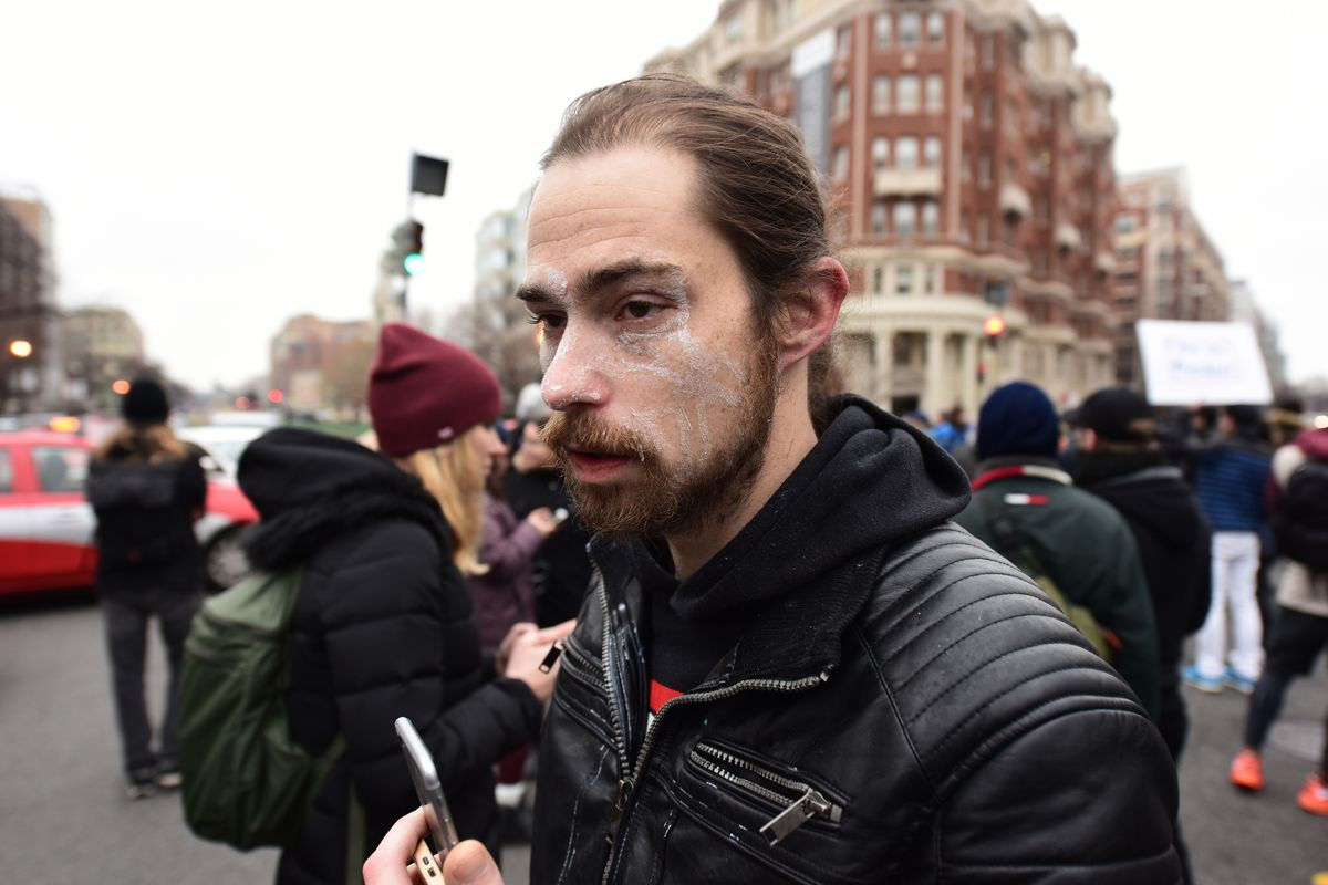 A protester has liquid around his eyes after being pepper sprayed.