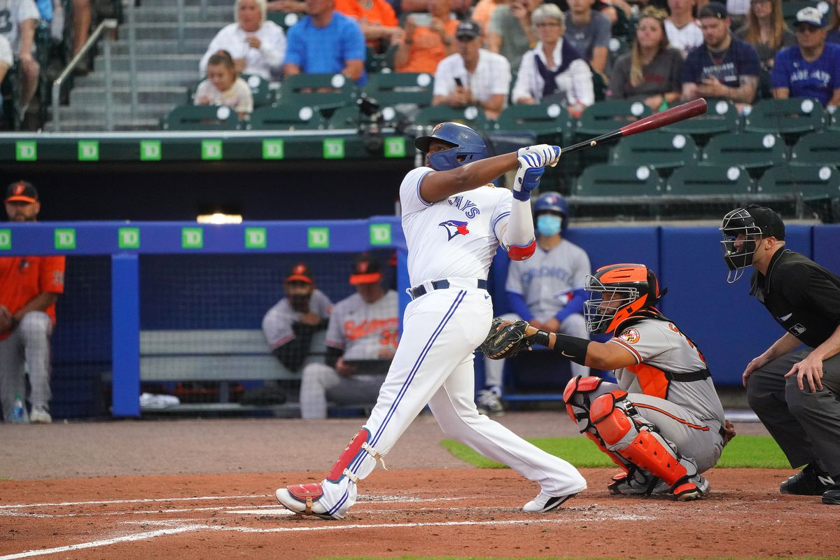 Vladimir Guerrero Jr. #27 of the Toronto Blue Jaysd hits a home run as Pedro Severino #28 of the Baltimore Orioles catches in the second inning at Sahlen Field on June 24, 2021 in Buffalo, New York.
