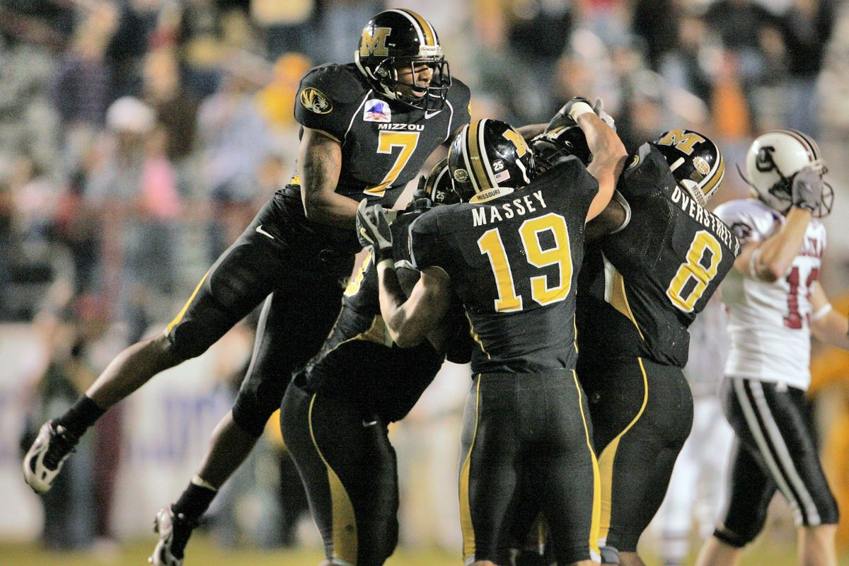 Missouri players celebrate their 38-31 win against South Carolina, Friday, December 30, 2005, at the Independence Bowl in Shreveport, Louisiana.