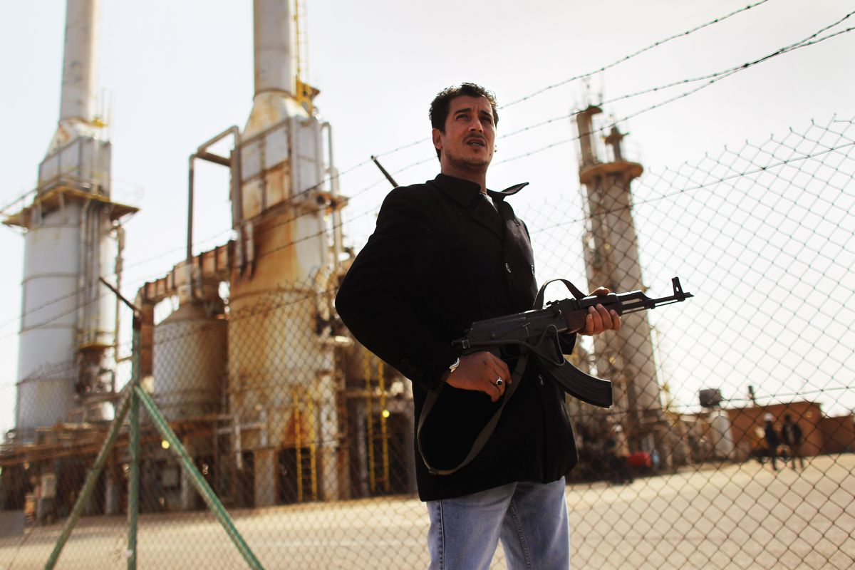 A Libyan fighter in eastern Libya, where there's oil.