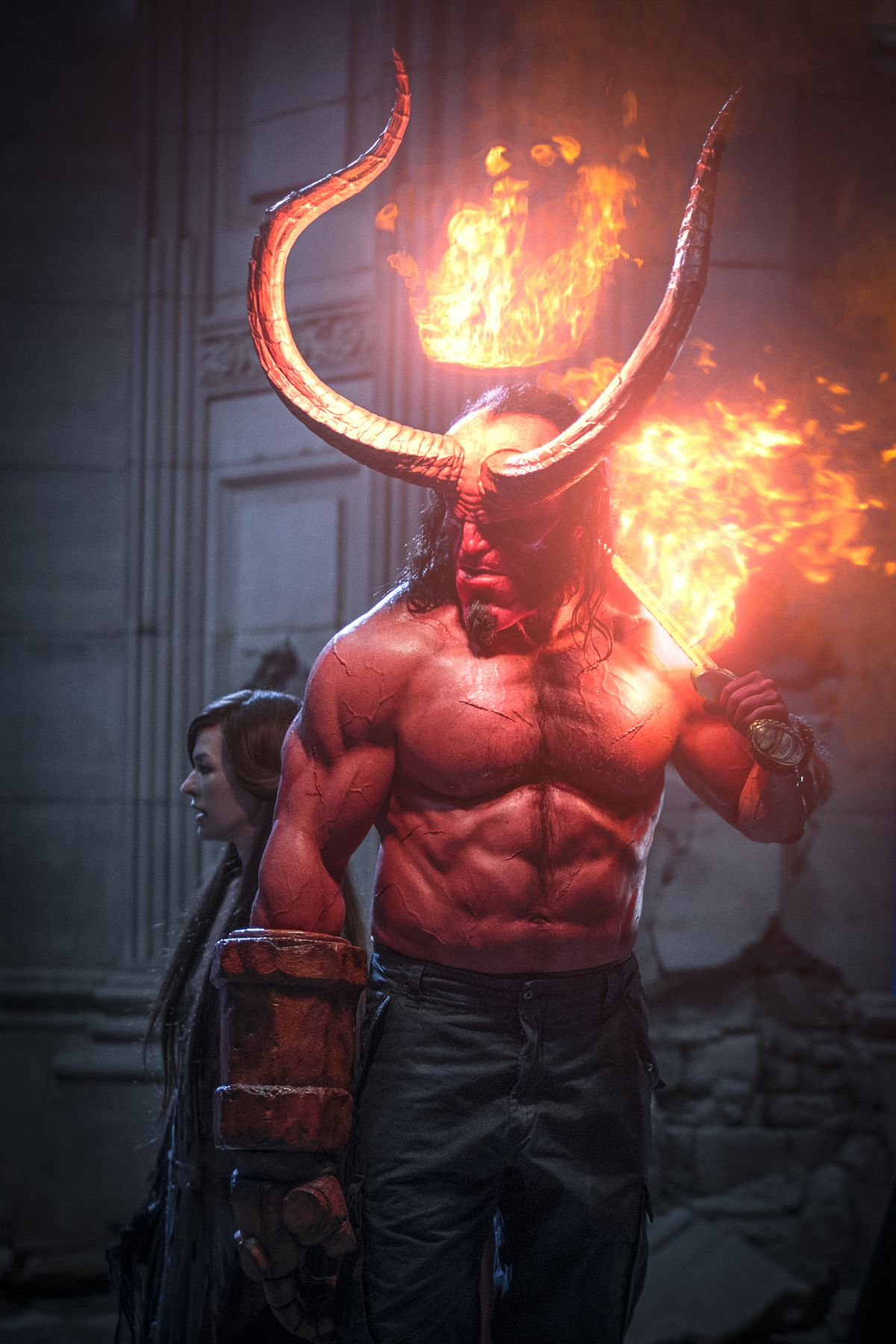 Milla Jovovich as 'Nimue the Blood Queen' and David Harbour as 'Hellboy' in HELLBOY. Photo Credit: Mark Rogers.