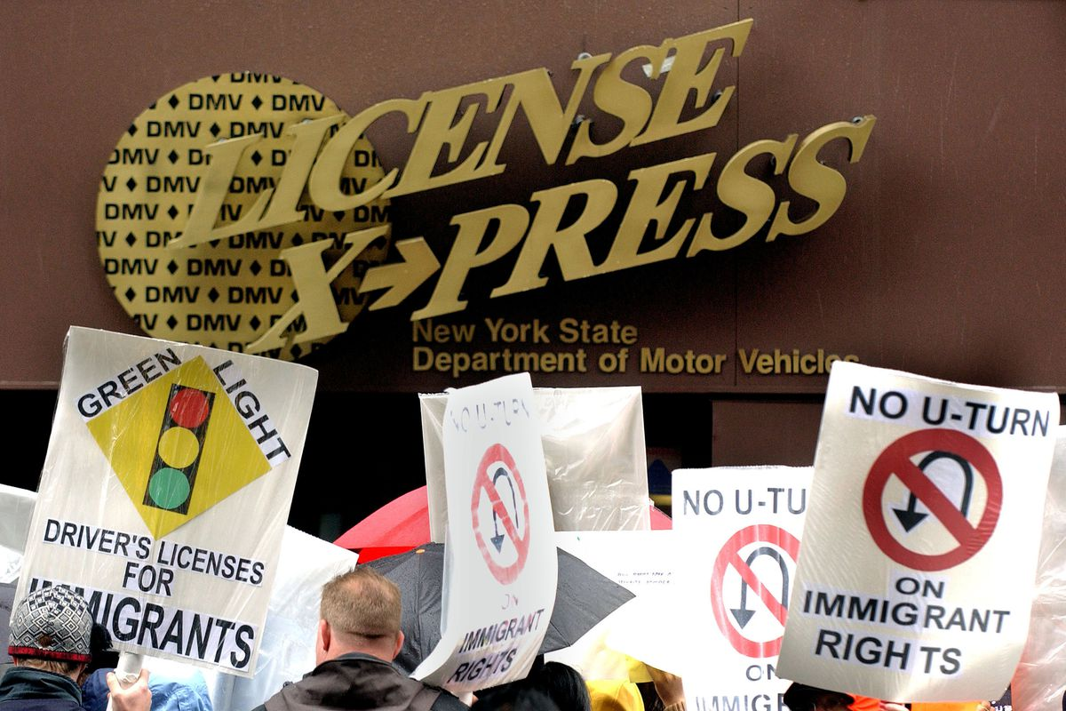 """Their signs say, """"No U-turn on immigrant rights."""""""