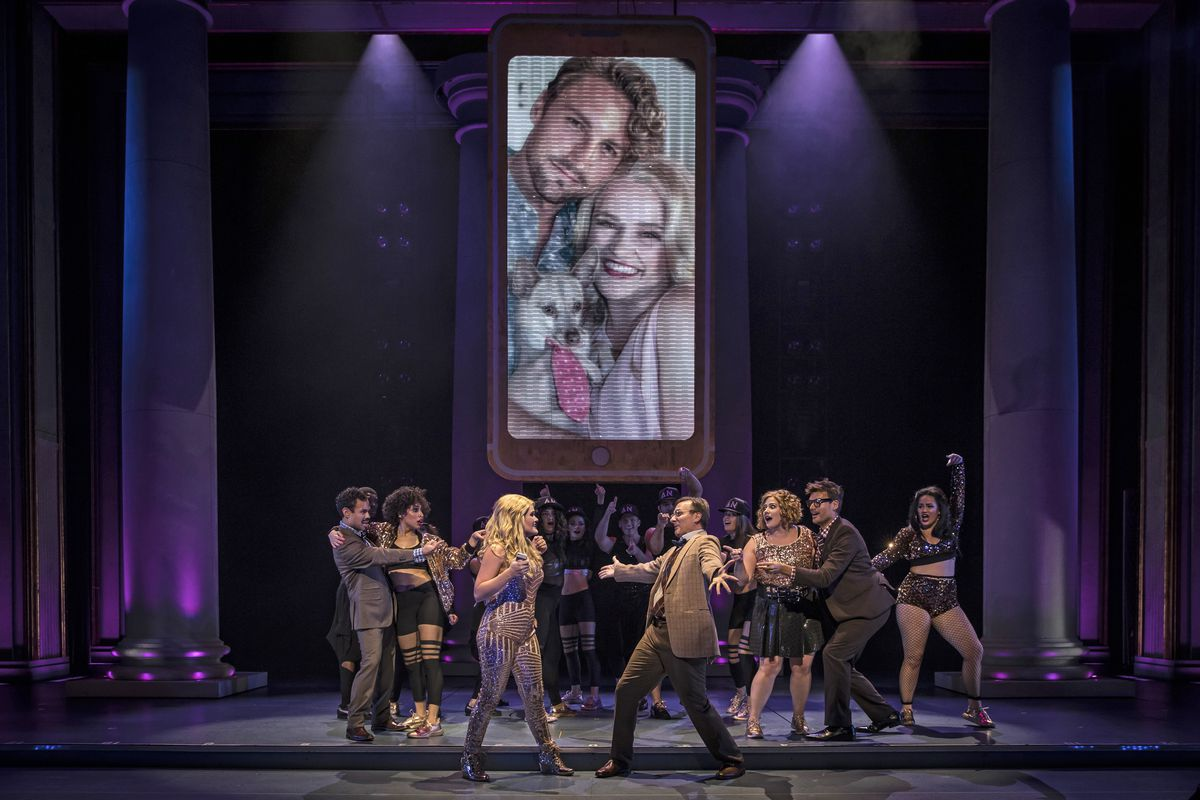 """The #MeToo movement and the advent of iPhones play big parts in Paramount Theatre's updated take on """"Legally Blonde"""" starring Casey Shuler as Elle Woods (center, with Michael Ehlers, and above in the oversized iPhone selfie with Tyler Lain as Warner Hunti"""