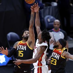 Utah Jazz forward Royce O'Neale (23) is called for a foul as he and Utah Jazz center Derrick Favors (15) defend Miami Heat forward Jimmy Butler (22) as the Utah Jazz and the Miami Heat play an NBA basketball game at Vivint Smart Home Arena in Salt Lake City on Saturday, Feb. 13, 2021. Utah won 112-94.