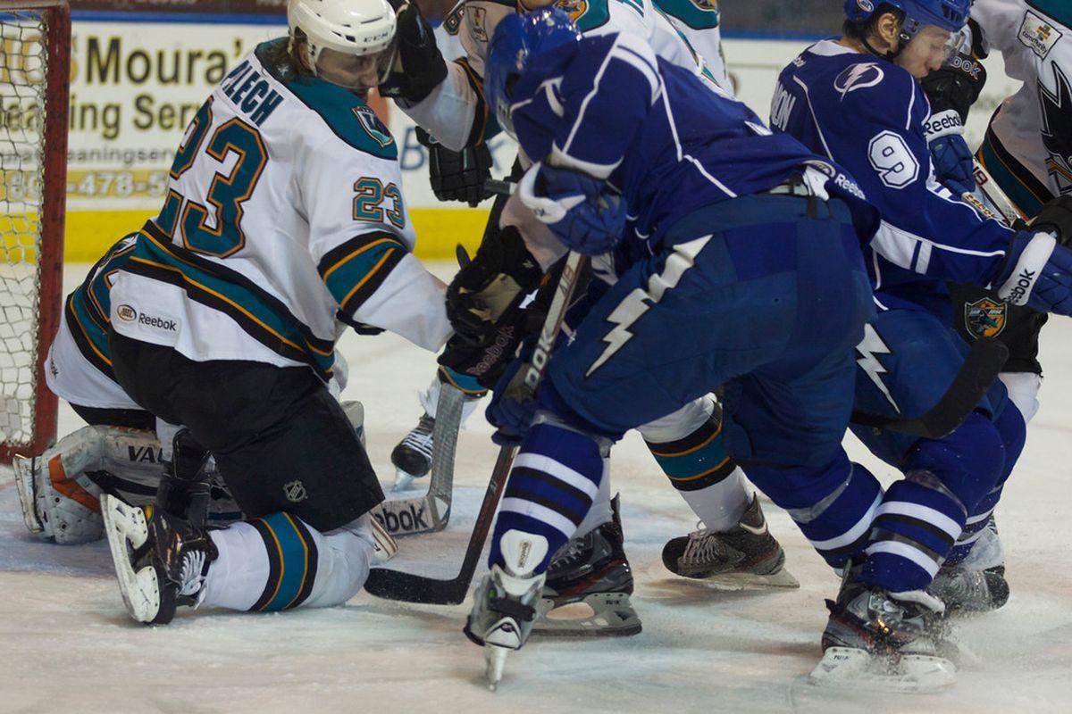 Worcester Sharks defenseman Matt Pelech battles for the puck in front of Sharks goaltender Alex Stalock at the DCU Center Sunday evening.