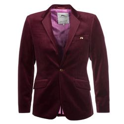 """Manny J: """"Moods of Norway (7964 Melrose Ave) offers that desired European slim fit and sizes ranging from 34 to an American 50. I recommend the Burgundy Velvet suit jacket and matching trouser as a great outfit for the upcoming Yuletide holiday and or New"""