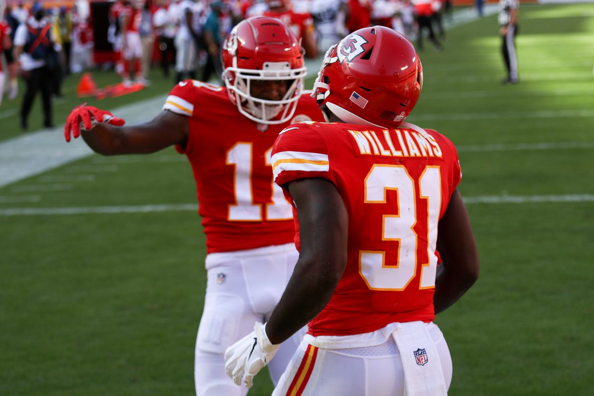 Darrel Williams #31 of the Kansas City Chiefs is congratulated by Demarcus Robinson #11 after a two point conversion against the Las Vegas Raiders during the fourth quarter at Arrowhead Stadium on October 11, 2020 in Kansas City, Missouri.