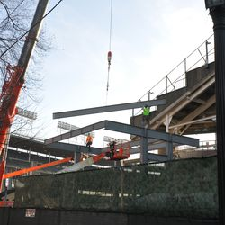 Steel beam being lowered into the right-center field patio -