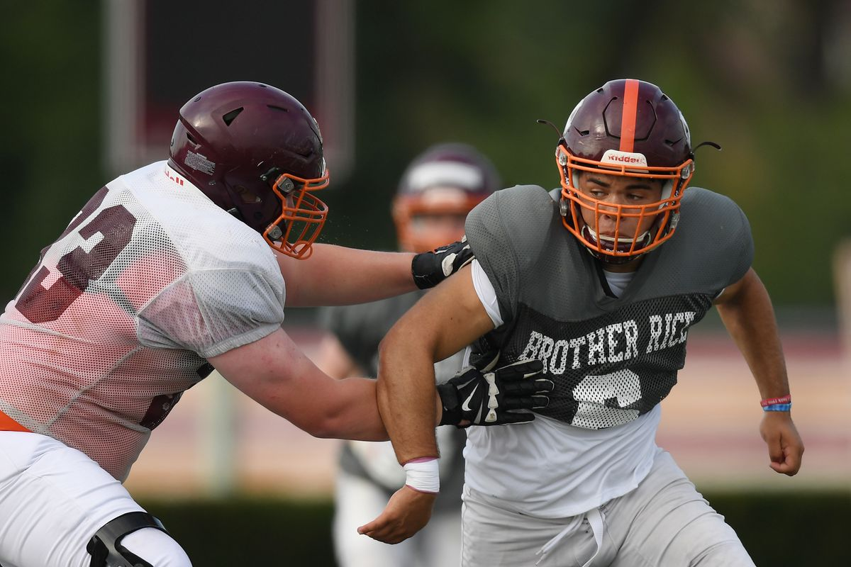Defensive lineman Kevin Frazier (6) of Brother Rice battles during practice.