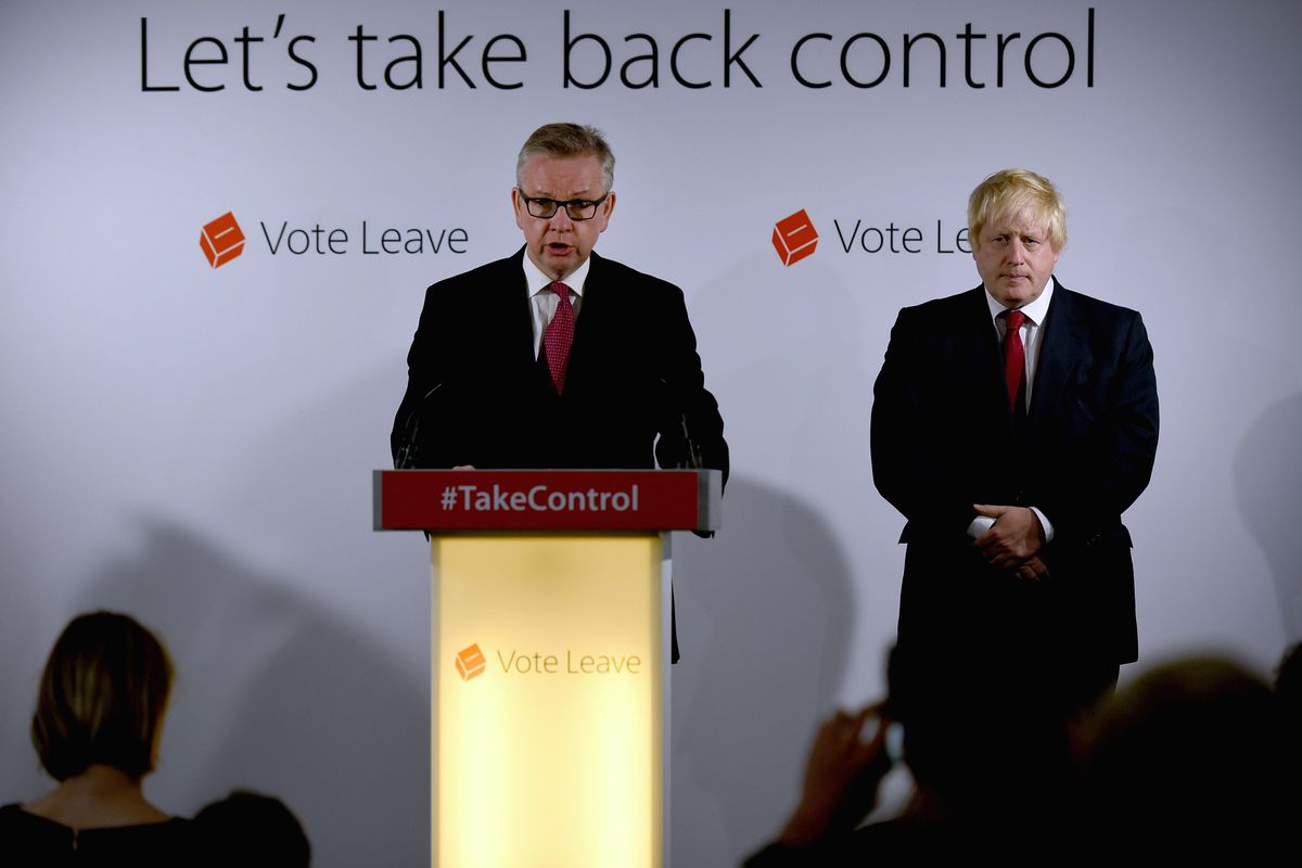 Boris Johnson listens to then-Justice Secretary Michael Gove speak following the results of the EU referendum at Westminster Tower on June 24, 2016, in London, England.