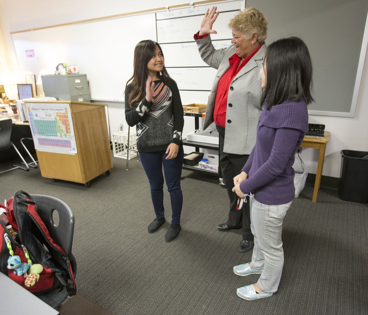 Barbara Brouwer (middle), principal at Southport High School, congratulates Emily Sung (left) and fellow Burmese student Elly Mawi. They are both recipients of a Lilly Endowment Community Scholarship.