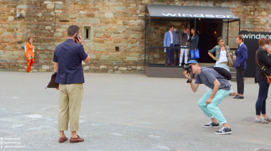 Man being photographed in street at Italy's Pitti Uomo