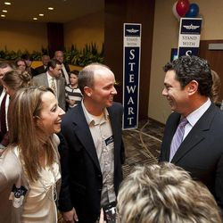 Rep. Jason Chaffetz, R-Utah, shares a laugh with Spencer Chase, center, at the Utah Republican Party results party, Tuesday, Nov. 6, 2012.