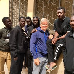 Elder Tom Herway (center), an LDS Church service missionary assisting with refugee efforts in Italy, meets in Lampedusa with a half-dozen migrants from Senegal and Gambia.