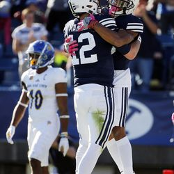 Brigham Young Cougars wide receiver Micah Simon and Brigham Young Cougars quarterback Tanner Mangum celebrate after a touchdown pass against San Jose State during NCAA football in Provo on Saturday, Oct. 28, 2017.