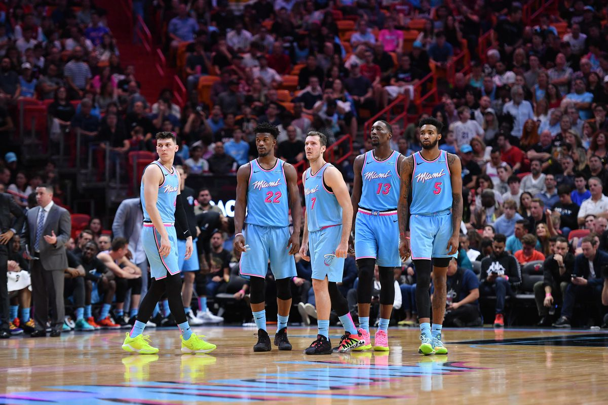 Miami Heat guard Tyler Herro, Miami Heat forward Jimmy Butler, Miami Heat guard Goran Dragic, Miami Heat center Bam Adebayo, and Miami Heat forward Derrick Jones Jr. come out of a timeout against the Philadelphia 76ers at American Airlines Arena.
