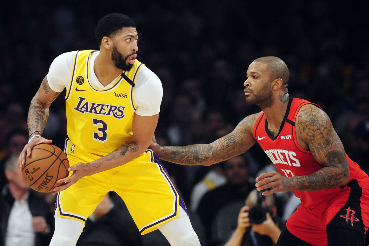 Los Angeles Lakers forward Anthony Davis controls the ball against Houston Rockets forward P.J. Tucker during the first half at Staples Center.