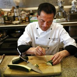 Hai Fitzgerald cuts a zucchini into a sculpture of a crab at Thyme and Seasons Restaurant in Bountiful on Monday, April 9, 2012.