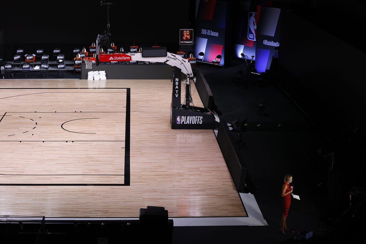 NBATV reporter Rebecca Haarlow does a live interview on an empty court during what would have been Game 5 of a first-round playoff series between the Bucks and Magic. The Bucks boycotted Wednesday's game to protest the shooting of Jacob Blake in Kenosha,