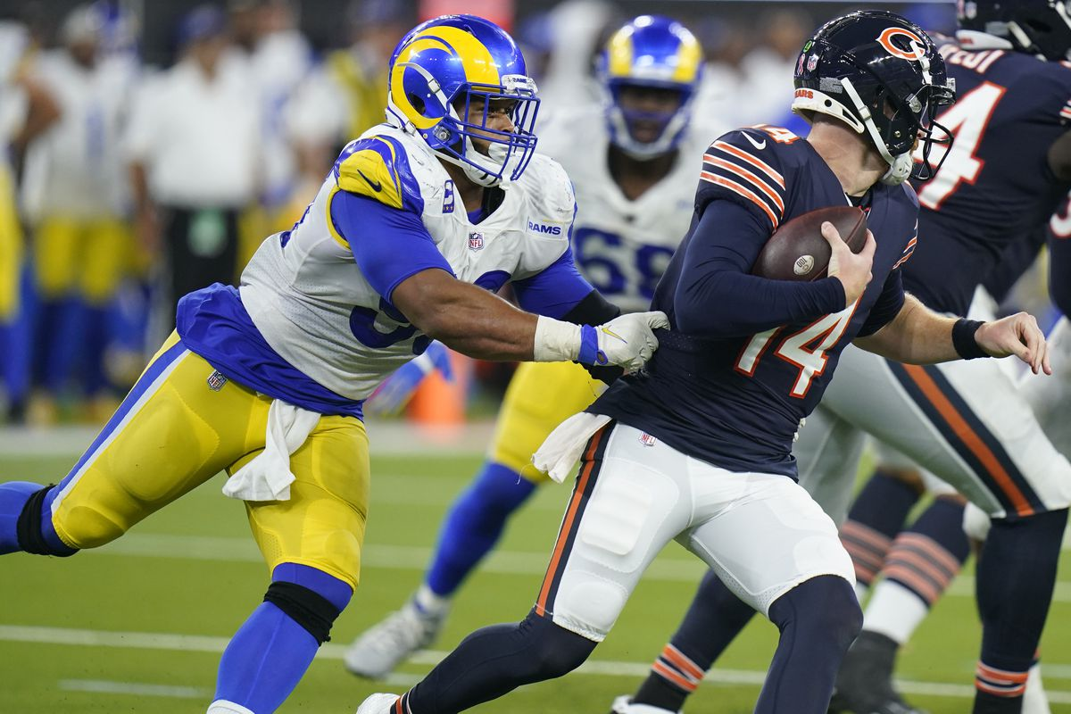 Bears quarterback Andy Dalton is hauled down by Rams defensive end Aaron Donald during the second half of Sunday's game.