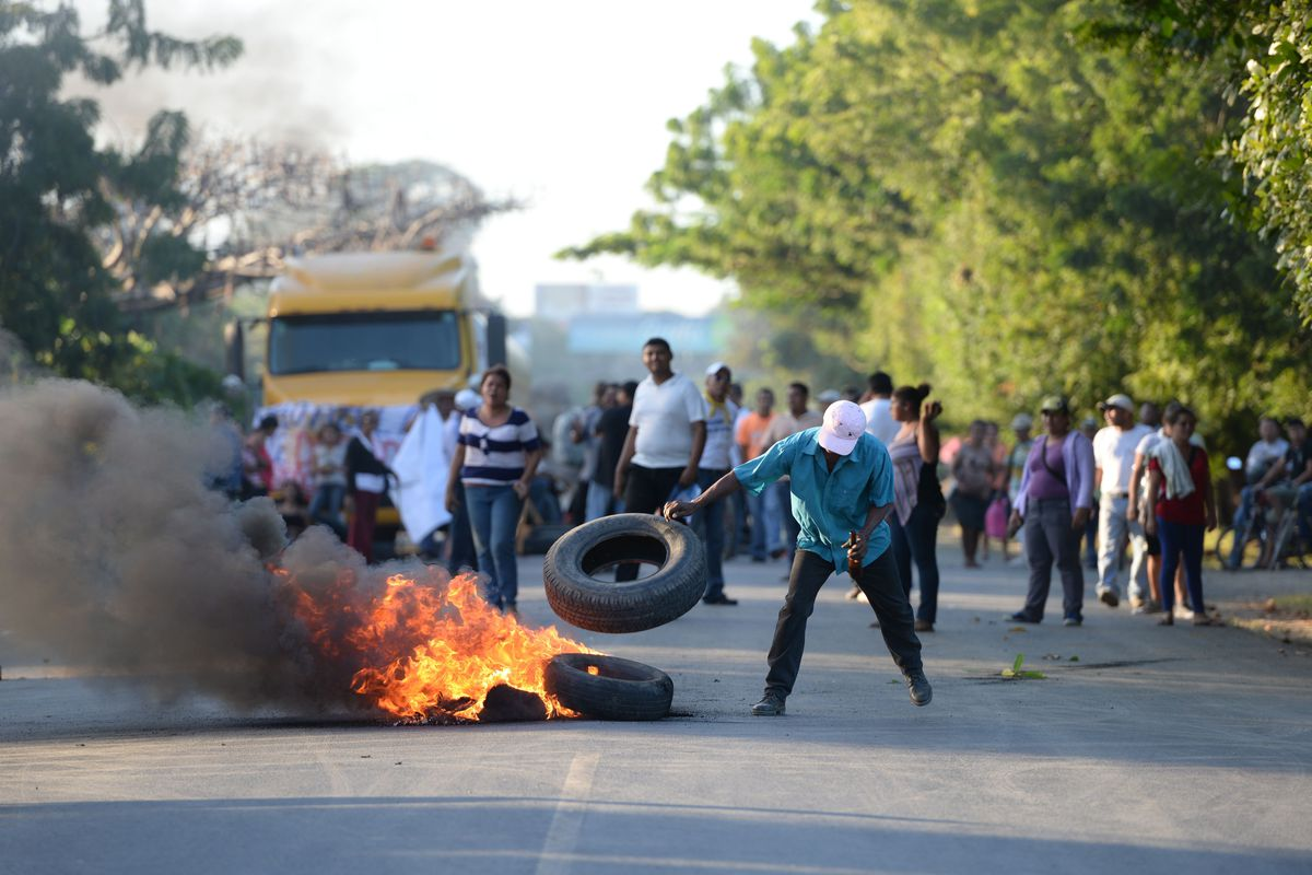 People protest burning tires against the inauguration of the works of an inter-oceanic canal in Rivas, Nicaragua on December 22, 2014.