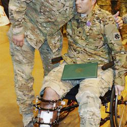 Wounded Spc. Kevin Summerlin, right, is one of the more than 1.6 million new veterans of the Afghan and Iraq wars.