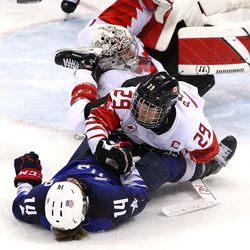 Marie-Philip Poulin #29 of Canada collides with Brianna Decker #14 of the United States in the third period.