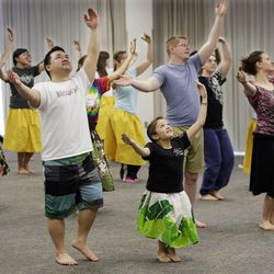 BYU student Kelsey Morasco and other students practice their BYU Luau 2012 dance routine in Provo Feb. 25, 2012.