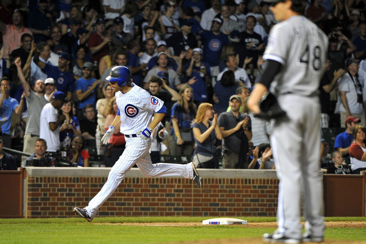 Chicago, IL, USA; Chicago Cubs third baseman Joe Mather hits a two run home run against the Chicago White Sox at Wrigley Field. The White Sox beat the Cubs 7-4. Credit: Rob Grabowski-US PRESSWIRE