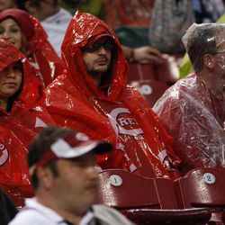 Cincinnati Reds fans try to stay dry as rain falls in the third inning of a baseball game against The San Francisco Giants, Wednesday, April 25, 2012, in Cincinnati.