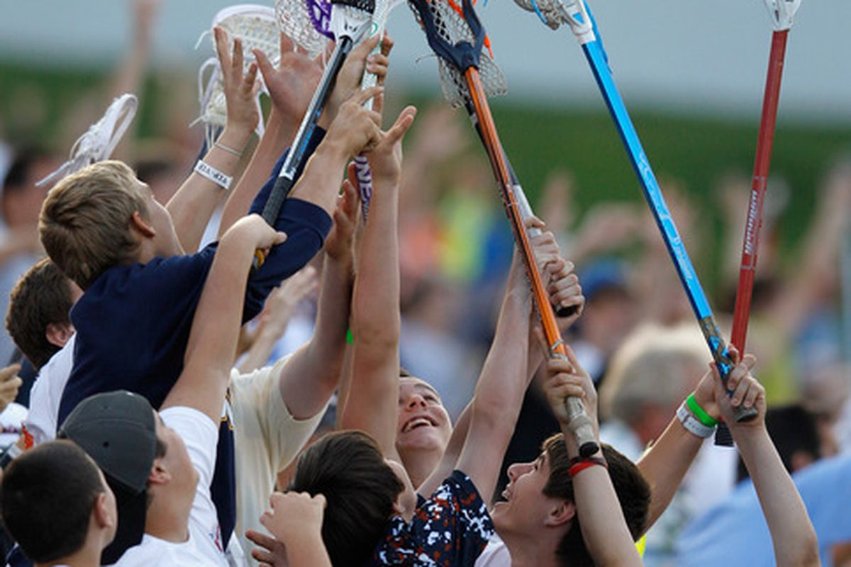 ANNAPOLIS, MD - JUNE 16: Lacrosse fans go up for a free t-shirt during a timeout of the Chesapeake Bayhawks and Hamilton Nationals game at Navy-Marine Corps Memorial Stadium on June 16, 2012 in Annapolis, Maryland.  (Photo by Rob Carr/Getty Images)