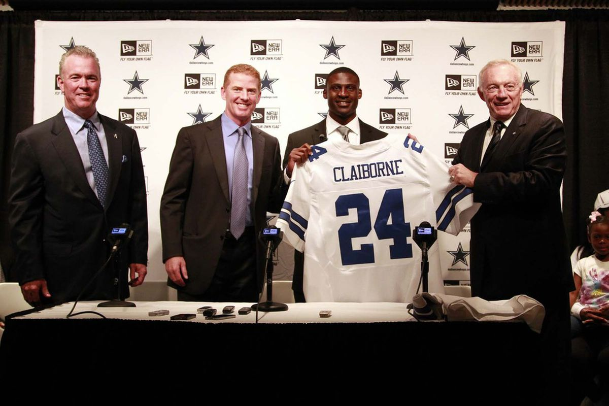 It's a team effort. Stephen Jones, Jason Garrett, and Jerry Jones (shown here welcoming first round pick 6 Morris Claiborne) are now the troika running the Dallas Cowboys.