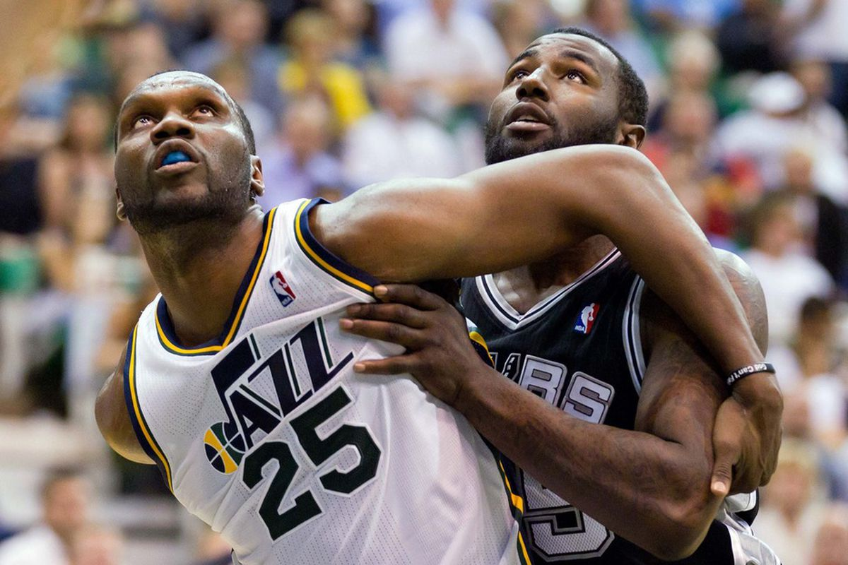 May 7, 2012; Salt Lake City, UT, USA; Utah Jazz center Al Jefferson (25) and San Antonio Spurs forward DeJuan Blair (45) battle for position and who gets to go first in the conga line. Mandatory Credit: Russ Isabella-US PRESSWIRE