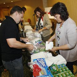 Derek Brown, member of the Utah House of Representatives and Utah Speaker of the House Becky Lockhart assemble humanitarian kits in Tampa, Florida.  The Republican National Convention was put on hold because of Hurricane Isaac but the Utah delegates used their extra time to put together humanitarian kits on Monday.  Delegates from Hawaii and Arizona helped out with the 1,000 hygiene kits and 100 back-to-school kits. Monday, Aug. 27, 2012